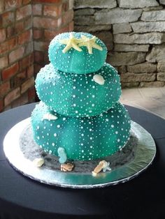 I love this cake! It is a three tier kina wedding cake....Kina is a sea urchin native to New Zealand....it was made by Tracy at Ariginal Cakes in Te Awamutu cute for a mermaid or sea underwater theme party birthday cake