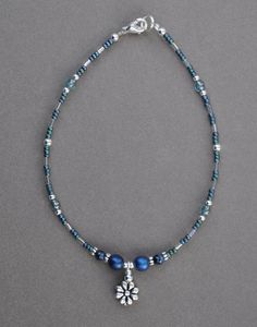 Hey, I found this really awesome Etsy listing at https://www.etsy.com/listing/222803912/blue-flower-beaded-anklet