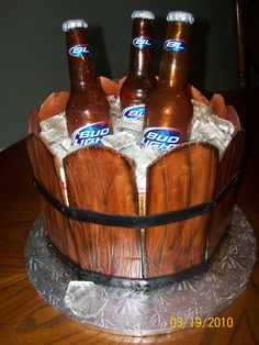 Bucket of Cold Beer Cake - this is the first time I have made this cake... I'm very happy with the way it came out... I got a call from the person this cake was for , and he told me everyone loved the cake.. they had it one the table, and the Birthday man, grabbed a bottle out of the bucket not knowing it was a cake...  I love story like this... What fun!! thanks for looking