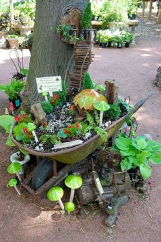 A charming little fairy garden in an old and vintage wheelbarrow that you can move around in your garden! :)
