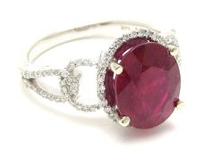 Oval cut rich RED RUBY & Diamonds engagement ring via Etsy.
