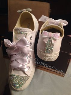 Bridal sneakers. White leather converse with rhinestone bling and sequin bow. Wedding sneaker made by me. Instagram @melscustomcrafts
