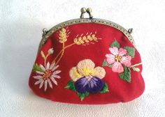 A little hand embroidered bag https://www.etsy.com/listing/188274469/hand-embroidered-little-bag-red-wool?ref=shop_home_active_1
