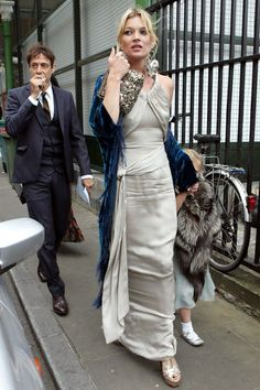 Kate Moss wearing Chanel and blue kimono at a friends wedding (with Jamie Hince and Lila Grace).