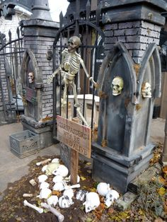 Halloween cemetery pillars, bones & sign