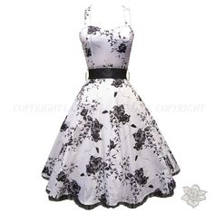 I am completely in love with this dress. With a pink belt, shoes and flowers.