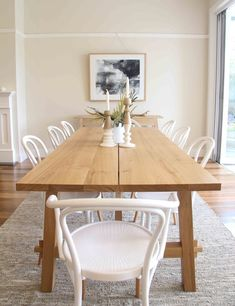 Large Oak Dining Table from IKEA is the perfect addition to this Scandinavian dining room with white bentwood armchairs.