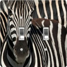 "Rikki KnightTM Zebra Face Close-Up Double Toggle Light Switch Plate Cover by Rikki Knight. $13.99. The Zebra Face Close-Up single toggle light switch cover is made of commercial vibrant quality masonite Hardboard that is cut into 5"" Square with 1'8"" thick material. The Beautiful Art Photo Reproduction is printed directly into the switch plate and not decoupaged which make these Light Switch Plates suitable for use in any room in the office, home, etc. etc.. These Light Switc..."