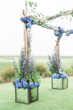 hydrangea adorned driftwood wedding arbor / http://www.deerpearlflowers.com/driftwood-wedding-decor-ideas/