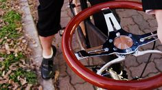 a steering wheel becomes this recycled bike's handlebar - designboom | architecture & design magazine