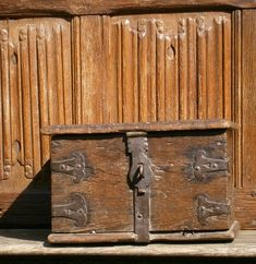 """16th century iron bound church poor box circa 1560. Of board construction with iron brackets to the corners with pierced heart shaped design and iron strap going around the front, back and base. Coin slot to the top,the hinges have been changed over the years. By repute from rutland church to one of the wardens for services to the church. Dimensions13"""" wide 8"""" high 10"""" deep."""