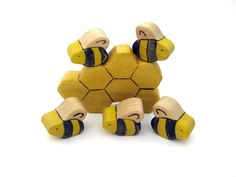 @Ann Degenhard:   look at this!  Honey Bees & Honeycomb Toy  Handmade Wooden Toy by ArmadilloDreams, $15.00