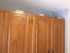 It doesn't take much time to add some drama to your kitchen or laundry room cabinets. Here are step by step instructions, including a list of supplies and tools, to extend your cabinets to the ceiling! Kitchen Cabinets To Ceiling, Kitchen Soffit, Laundry Room Cabinets, Black Kitchen Cabinets, Custom Kitchen Cabinets, Painting Kitchen Cabinets, Diy Cabinets, Kitchen Redo, Kitchen Remodel