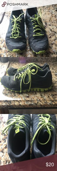 Reebok realfkex sneaker Good condition  men's sneaker  size 10 1/2 Gray with the neon green shoelace Reebok Shoes Sneakers