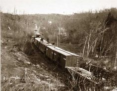 Orange and Alexandria R.R. near Union Mills, Virginia. It was taken between 1861 and 1865.The image shows Soldiers on top of train boxcars.