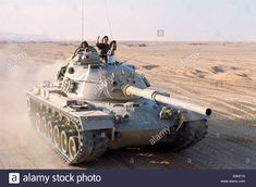 An Israeli tank roars towards to frontline after crossing the Suez Canal.