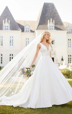 This beautiful mikado satin wedding dress is reminiscent of the royal weddings. With a pretty neckline, soft pleats and a full ballgown skirt Stella York 6758 is an incredible wedding dress. Available from Caroline Clark Bridal Boutique, Droitwich