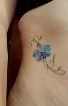 The tattoo I got from Lauren Roberts at Adara Tattoo Collective, York. Blue orchid, tendrils.