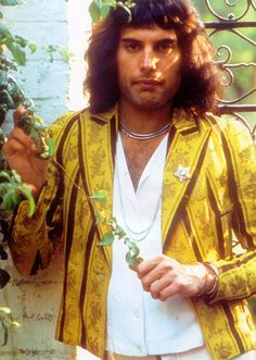 Freddie at home (London), in his  garden. As much as possible with a busy touring schedule, he personally cared for all the roses. It was a typical/ beautiful English garden.