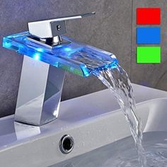 Specification: Waterfall, LED One Hole Finish Chrome Style: Contemporary Flow Rate: 2 GPM L/min) Valve Type: Ceramic Valve Battery Type AA Cold and Hot Switch: Yes Material: Faucet Body Material Brass Faucet Spout Material Glass Faucet Handle Materi Bathroom Design Luxury, Modern Bathroom, Master Bathroom, Glass Bathroom Sink, Mosaic Bathroom, Bathroom Fixtures, Faucet Handles, Brass Faucet, Dream Bathrooms