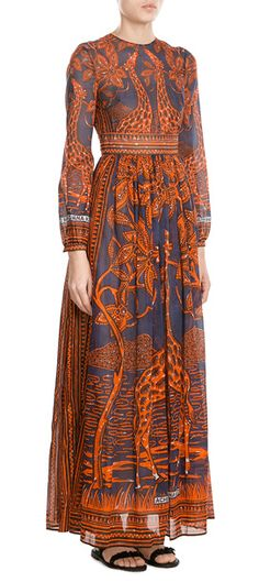 Valentino's+floor-grazing+print+maxi+dress+is+styled+with+an+exotic,+travel-inspired+print+and+colored+in+bright+orange+and+rich+navy.+The+long+sleeves+make+it+an+elegant++and+modest+choice,+while+the+slightly+sheer+finish+is+subtly+sensual+#Stylebop