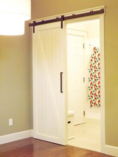 DIY barn door/used this in the River House and painted the doors black and love them. Great space saver and architectural interest piece. Sliding Door Room Dividers, Room Divider Doors, Diy Sliding Barn Door, Diy Barn Door, Diy Door, Sliding Doors, Barn Doors, Closet Doors, Hallway Closet
