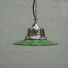 Mirror polished gallery with a green enamelled shade. A small lamp with an eye-catching presence.