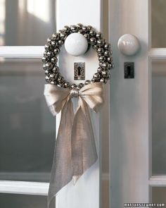 White Christmas / Jingle Bell Christmas Wreaths - These are so pretty and versatile as well as fun & easy to make - Jingle Bell Ring by Martha Stewart. Silver Christmas, Merry Little Christmas, Noel Christmas, Xmas, Elegant Christmas, Outdoor Christmas, Christmas Ornaments, Christmas Parties, Simple Christmas