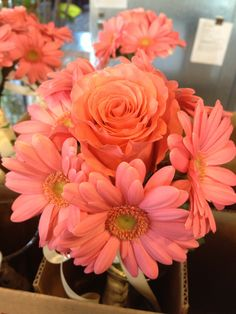 Bridesmaids bouquet. Coral gerber daisies and coral rose. Crystal Rose Florist Folsom CA
