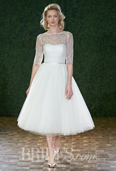"""Brides.com: Encore - Spring 2015. Style 6741E, """"Rho"""" tea-length lace and tulle ball gown wedding dress with an illusion high neckline and elbow length sleeves, Encore by Watters"""