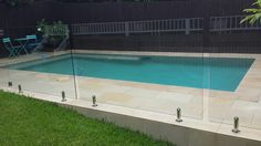Sawn and sandblasted sandstone paving and coping around pool. Sawn and sandbla Glass Pool Fencing, Glass Fence, Pool Fence, Pool Decks, Front Yard Fence, Fenced In Yard, Farm Fence, Fence Gate, Backyard Pool Landscaping