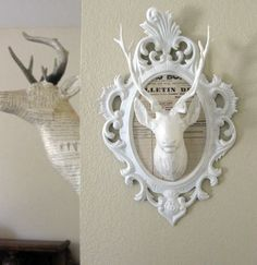 repurposed deer head in frame. plastic components painted with gesso.