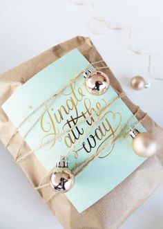 9/50 Christmas-tree-inspired We love that this gift is wrapped just like a Christmas tree! The gold foil message on the card could also be personalised to suit the person you're gifting it to by following our gold foil tutorial here.