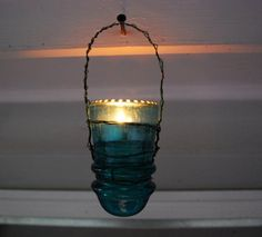 Antique glass insulator luminaria.  These would look cute hanging around a deck