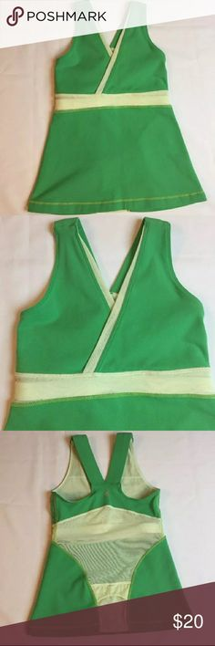 """Lululemon green tank 2 with yellow mesh Lululemon green tank with yellow mesh. Measurements compare with size 2 on sizing chart on Lululemon website, tag has been removed.  chest: 12""""  waist: 12""""  length: 21""""   Smoke and pet free home. B026 lululemon athletica Tops Tank Tops"""