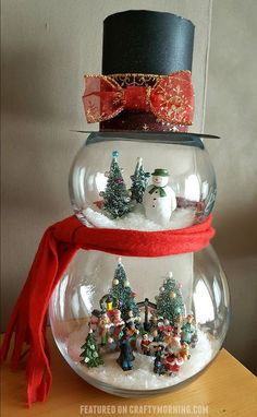 8 Easy DIY Ways To Decorate Your Home For Christmas - Twins Dish : Easy DIY Fish Bowl Snowman. Elegant Christmas Decoration idea for the mantle, table, wedding, party. Great budget decor for the home or apartment. Snowman Christmas Decorations, Snowman Crafts, Cute Crafts, Christmas Projects, Holiday Crafts, Christmas Ornaments, Christmas Ideas, Snowman Globe Craft, Apartment Christmas Decorations