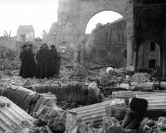 Italian Catholic priests and civilians stand amid the ruins of a church at an unidentified location, late 1944. Dogged resistance by retreating German forces caused great damage to residential areas, which often became the scene of brutal fighting.