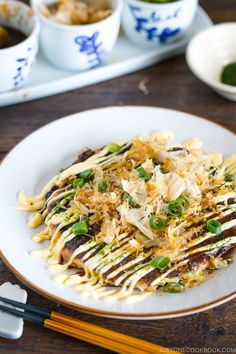Okonomiyaki, popular street food from Osaka, Japan, is a savory version of Japanese pancake, made with flour, eggs, shredded cabbage, and your choice of protein, and topped with a variety of condiments. #okonomiyaki #japanesefood   Easy Japanese Recipes at JustOneCookbook.com Japanese Street Food, Thai Street Food, Japanese Food, Japanese Meals, Indian Food Recipes, Asian Recipes, Vegetarian Recipes, Ethnic Recipes, Indian Snacks