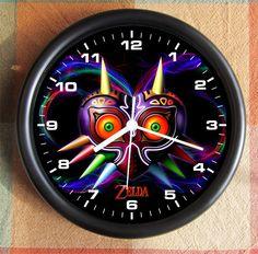 LEGEND OF ZELDA Majoras Mask Blue Big 10 inch black wall clock by AllGreatStuf on Etsy https://www.etsy.com/listing/156471425/legend-of-zelda-majoras-mask-blue-big-10
