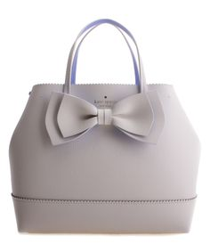 A bold bow and luxe leather combine feminine and high-end, and a spacious interior comfortably stores your essentials.     California customers, clickfor important Prop 65 information
