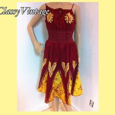 Burgundy and orange batik  style dress NWT Stunning burgundy and orange dress. NWT this is just below knee and features a smocked waist. The straps are adjustable as it ties at front neckline. Beautifully embroidered  and hand dyed batik design so each is slightly different. 100% Rayon. Boutique Dresses