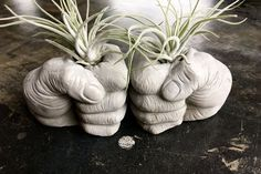Fist Bump (noun): a gesture similar in meaning to a handshake or high five. A fist bump can also be a symbol of giving respect. This quirky listing Fist Bump Concrete Planters Bookends by AnsonDesign on Etsy How to make cement planters using old rags I us Cement Art, Concrete Art, Concrete Garden, Concrete Planters, Hand Planters, Concrete Table, Diy Home Crafts, Garden Crafts, Garden Projects