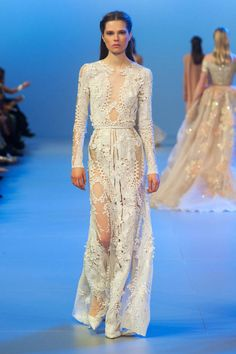 Elie Saab Couture Spring 2014. Click through to see all of our favorite looks!MORE KINK: http://afemaria.com/2011/07/20/elie-saab/