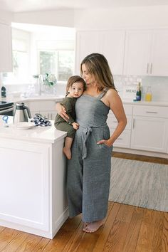 A mom The Patty Jean Jumpsuit in Chambray, while holding her son in a brightly lit kitchen. Chambray Jumpsuit, Jeans Jumpsuit, Nursing Wear, Nursing Clothes, Mom Outfits, Stylish Outfits, New Wardrobe, Wardrobe Staples, Breastfeeding Dress