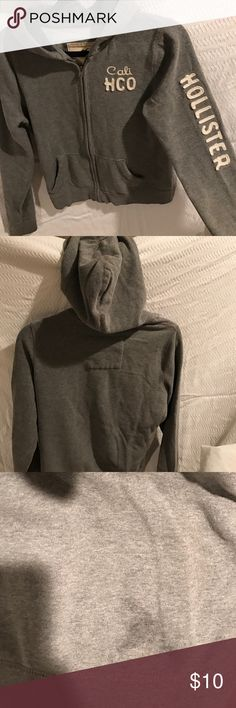 Hollister hoodie Grey and cream Hollister hoodie. Small washable smudge back bottom. Hollister Jackets & Coats