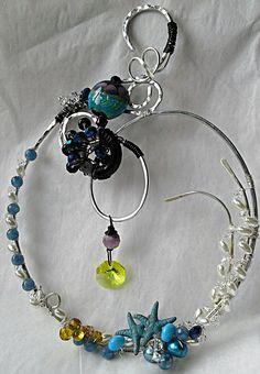 """Sea of Dreams"" suncatcher using gifted lampwork, swarovski, pearl, starfish. Suncatchers, Starfish, Wire Wrapping, My Design, Swarovski, Soup, Bead, Dreams, Pearls"