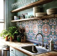 Graphic kitchen tiling, wooden counter & shelves
