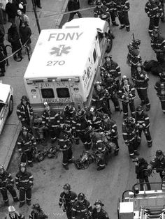 NY firemen wait at collapsing construction site by Ray Wu