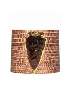 """This unique cuff features Arizona Lizard embossed cowhide leather. Adorned with a Smokey Topaz Arrowhead gilded in Gunmetal Measurements: The cuff is 9"""" x 2"""" in length and is finished with Gunmetal Snaps and is adjustable to fit most wrist sizes. It is lightweight, comfortable and is fashionable for all seasons. ** Note these are note genuine exotic reptile skins - they are embossed leather** Product Care: Avoid exposure to water, lotion and perfume. Clean with a damp jewelry cloth..."""
