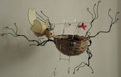 bird 's nest in wire and paper